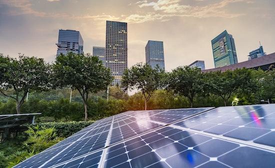 solar panel plant with urban landscape